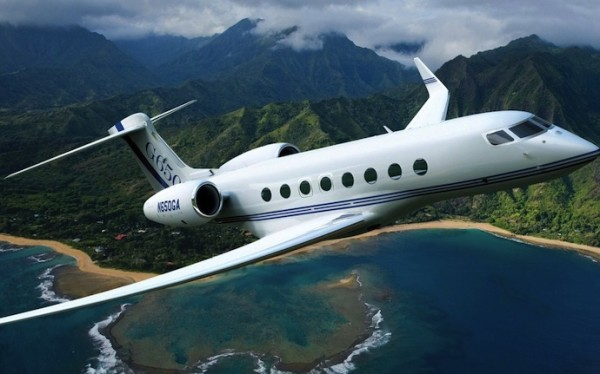 the g650 flying over an island, the fastest private jet available today